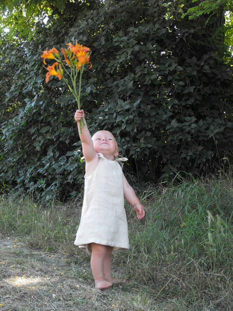 proudly walking barefoot in an organic cotton dress